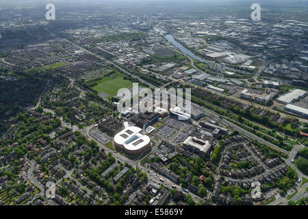 An aerial view looking from Salford towards Salford Quays and the Manchester Ship Canal - Stock Photo