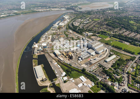 An aerial view showing Runcorn and Widnes, towns in Cheshire UK either side of the River Mersey. - Stock Photo