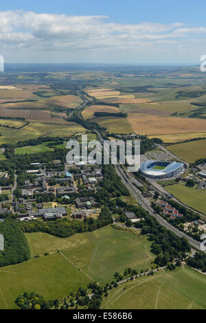 An aerial photograph showing the University of Sussex campus, the Falmer Stadium and the rolling South Downs in - Stock Photo