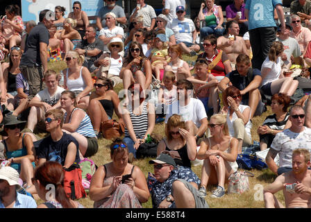 Builth Wells, Powys, Wales, UK. 23rd July, 2014. Weather: Sunbathers at the Royal Welsh Show.   Sunbathers soak - Stock Photo