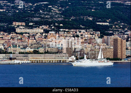 Waterfront view of city skyline and mountains, Monte Carlo, Monaco - Stock Photo
