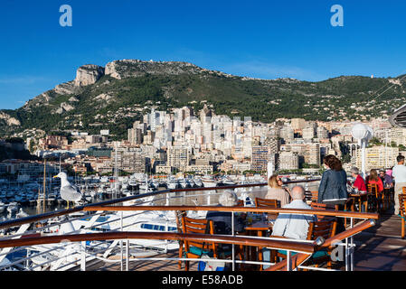 Waterfront view from docked cruise ship of city skyline and mountains, Monte Carlo, Monaco - Stock Photo