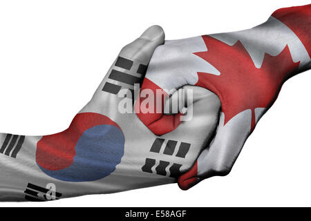 Diplomatic handshake between countries: flags of South Korea and Canada overprinted the two hands - Stock Photo