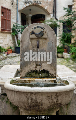 A rustic water fountain in a courtyard in the village of St Paul de Vence, Provence, France - Stock Photo