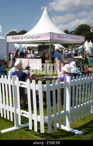 White picket fence and marquee at Tatton Park, Manchester, UK 23rd July, 2014. Pimms and Champagne outside at RHS - Stock Photo