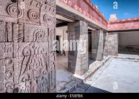 Stone carved pillars line the interior of the Quetzalpapalotl's Palace in Teotihuacan, Mexico. - Stock Photo