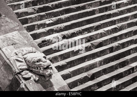Monochrome image of a serpent head and steps at the temple of Quetzalcoatl, Teotihuacan, Mexico. - Stock Photo