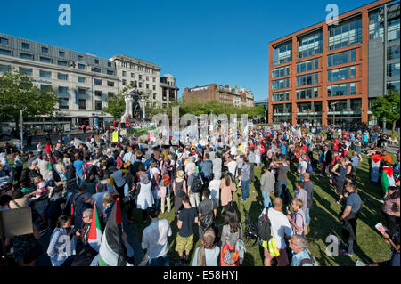 Manchester, UK. 23rd July, 2014. Hundreds of people attend a demonstration in the Piccadilly Gardens area of Manchester - Stock Photo