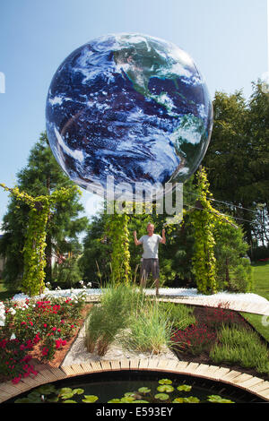 Inflatable floating Globe in Tatton Park, Manchester, UK. 23rd July, 2014. Circular images of Tethered Earth_ Jonathen - Stock Photo