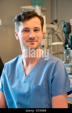 Male doctor with eye test equipment - Stock Photo