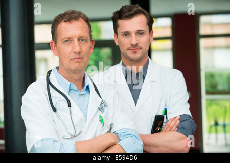 Portrait of two male doctors - Stock Photo
