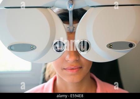 Female patient having eye examination - Stock Photo