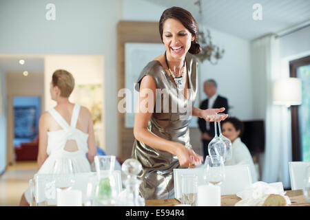 Woman setting table for party - Stock Photo