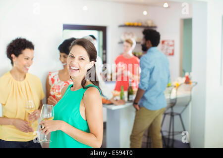 Woman laughing at party - Stock Photo