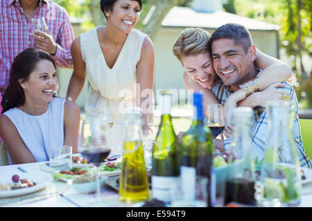 Friends relaxing together at party - Stock Photo