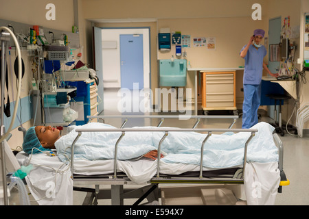 Female patient in recovery room - Stock Photo