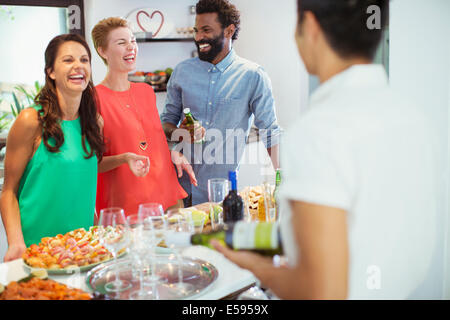 Friends laughing together at party