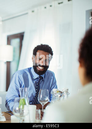 Couple eating together at table - Stock Photo