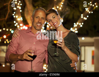 Couple drinking wine together outdoors - Stock Photo