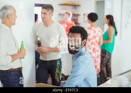 Man smiling at party - Stock Photo