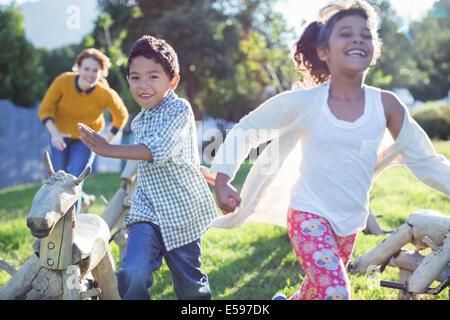 Children running in field - Stock Photo