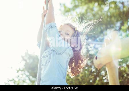 Children climbing outdoors - Stock Photo