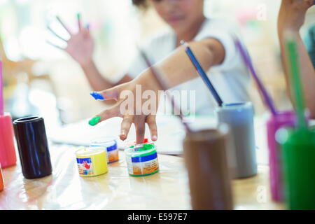 Student finger painting in class - Stock Photo