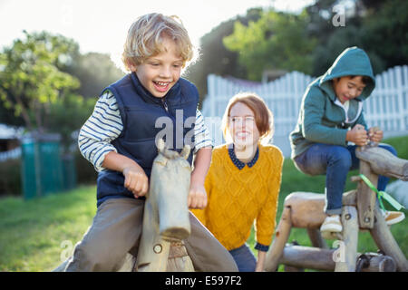 Teacher and students playing outdoors - Stock Photo