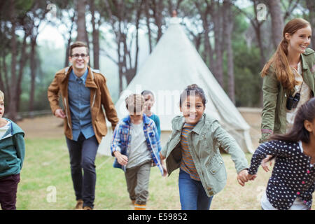 Teachers and students walking in forest - Stock Photo
