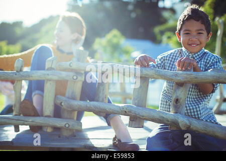 Teachers and students playing on play structure - Stock Photo