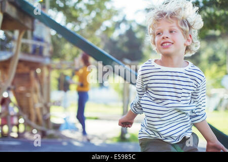 Boy playing on play ground - Stock Photo