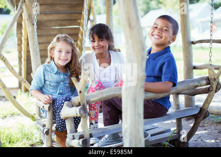 Children playing on play structure - Stock Photo