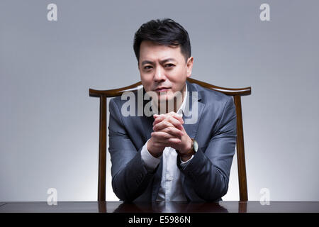 Wealthy mature businessman - Stock Photo