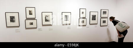 Berlin, Germany. 24th July, 2014. A woman looks at pictures by American photographer Walker Evans in the exhibition - Stock Photo