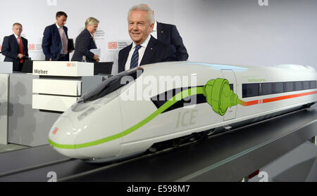Berlin, Germany. 24th July, 2014. CEO of Deutsche Bahn (DB) Ruediger Grube leaves the room after the DB midyear - Stock Photo