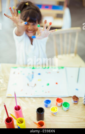 Student finger painting in classroom - Stock Photo
