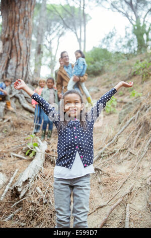 Girl holding arms out in forest - Stock Photo