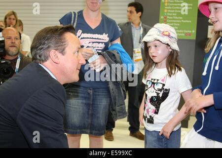 Glasgow, Scotland, UK. 24th July 2014. British Prime Minister David Cameron visits the Sir Chris Hoy Velodrome to watch the first session of track cycling and to meet athletes and volunteers Credit:  Neville Styles/Alamy Live News