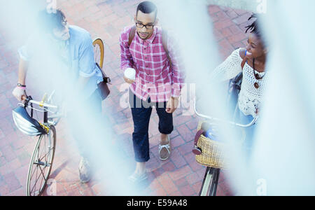 Friends walking on city street - Stock Photo