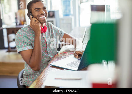 Man working at conference table in office - Stock Photo