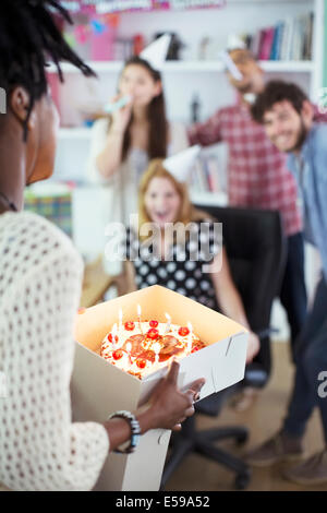 People celebrating birthday in office - Stock Photo
