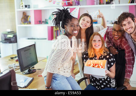 People celebrating birthday in office - Stock Photo