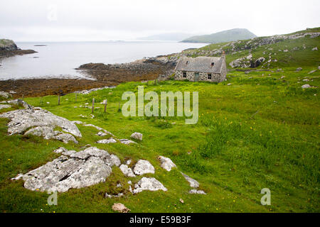 Deserted derelict croft cottage in coastal location at Port Deas an Uidhe, Vatersay Island, Barra, Outer, Hebrides, - Stock Photo
