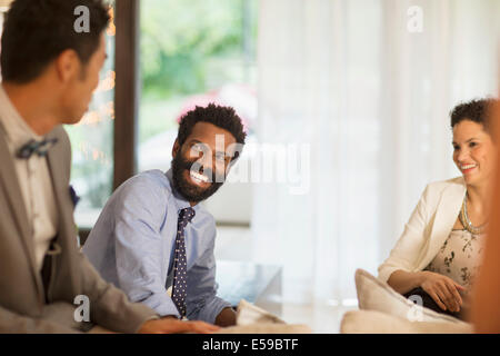 Friends talking at party - Stock Photo