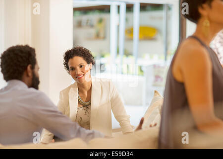 Couple talking at party - Stock Photo