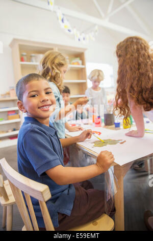 Student painting in classroom - Stock Photo