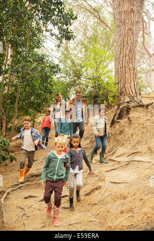 Students and teachers walking in forest - Stock Photo