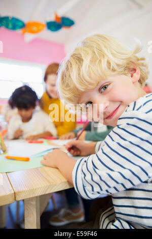 Student drawing in classroom - Stock Photo