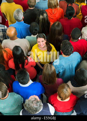Smiling woman in crowd - Stock Photo