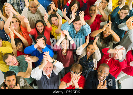 Portrait of diverse crowd clapping - Stock Photo